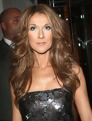 Celine Dion made her eyes pop with those ultra-long false lashes.