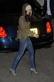 Cheryl Cole stepped out in gray Alexander McQueen ankle boots. The Chelsea boots feature a curved heel.