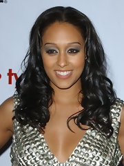 Tia Mowry knows how to highlight her best assets. The actress drew attention to her brown eyes with silver metallic eyeshadow.