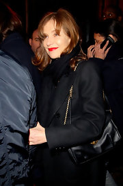 Isabelle Huppert contrasted her dark ensemble at the YSL fashion show with super red lips.