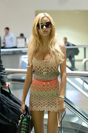 Zahia Dehar wore a pair of over-sized sunglasses while traveling through the Los Angeles airport.