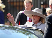 Autumn Phillips looked demure in a large straw hat with a white ribbon at Conongate Kirk.
