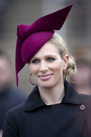 Zara Phillips attended The Cheltenham Festival in a fuchsia fascinator.