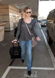 Renee Zellweger dressed down at LAX in a sheer long-sleeved charcoal t-shirt.
