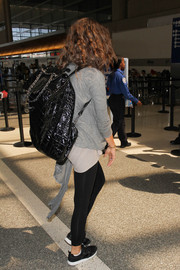Zendaya Coleman carried an oversized black patent backpack by Chanel while making her way through LAX.