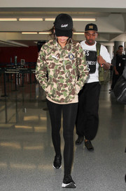 Zendaya Coleman completed her airport attire with a pair of black leather sneakers.