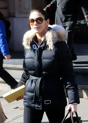 Catharine is cozy in her down coat. Here she's wearing tortise framed sunglasses.