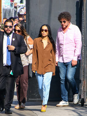Zoe Kravitz completed her look with a pair of yellow pumps.