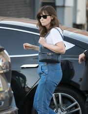 Zooey Deschanel styled her casual overalls with a chic quilted bag by Chanel for her visit to 'Jimmy Kimmel.'