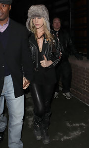 Kesha arrived for the fashionable event in a jumbled black ensemble completed by a pair of worn black leather, studded motorcycle boots.