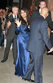 Janet's side swept long loose curls look beautiful against her navy blue belted dress.