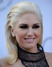 Gwen Stefani opted for sleek straight tresses at the amfAR gala. She slicked her locks back and curled the ends.