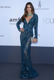 Izabel Goulart's long-sleeve sheer blue gown showed just a touch of skin and was super sexy!