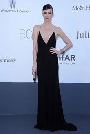 Paz Vega kept it simple and chic with a long black column dress that featured a plunging neck and spaghetti straps.