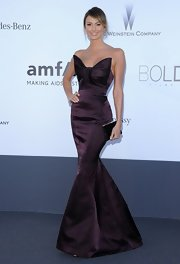 Stacy Keilbler wore this grape strapless mermaid gown with an oversized bow accented neckline.
