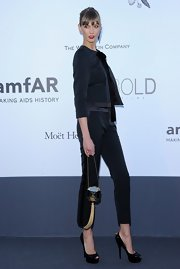 Karlie Kloss teamed black platform peep-toes with a pantsuit for a totally stylish finish at the amfAR Gala.