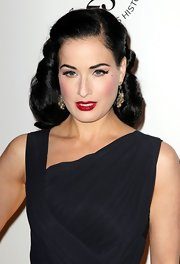 Dita Von Teese wore her shiny tresses pulled back at the amfAR Inspiration Gala. The rest of her glossy locks fell in smooth curls.