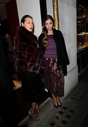 Amber Le Bon was seen outside the Salvatore Ferragamo store wearing a purple asymmetric skirt with gold floral print.