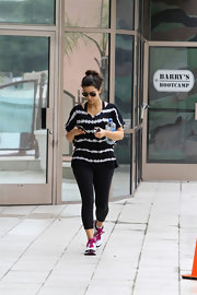 Kim Kardashian jazzed up her work out look with a tie-dye black-and-white T-shirt.