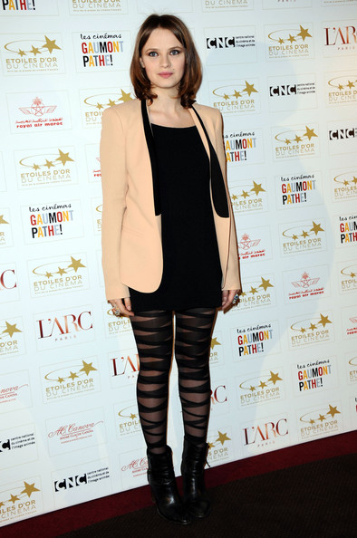 Sara Forestier teamed bold striped tights with black leather ankle boots.