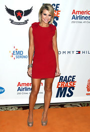 Chelsea Kane teamed her vibrant red frock with a pair of beige snakeskin pumps.