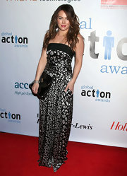 Hilary dons a silk abstract print evening gown for the Global Action Awards Gala.