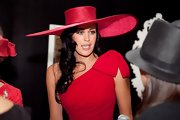 Megan Gale looked sassy at the 2009 BMW Caulfield Cup in her wide-brimmed red straw hat.