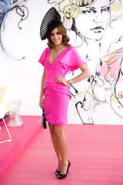Rebecca goes hot pink in a butterfly sleeve cocktail dress with black accessories.