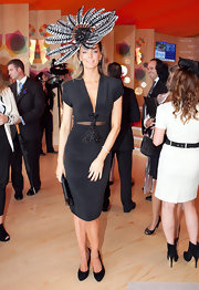 Jennifer adds some interest to her little black dress with an embellished center design with a cut out at the waist.