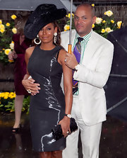 Melanie Brown paired her large hat and metallic dress with a simple black clutch.