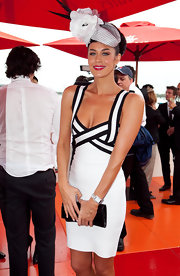 Megan Gale wore a silver rectangular watch to the AAMI Derby.