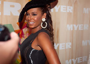 Melanie Brown paired her large decorative hat with gemstone hoop earrings.