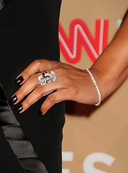 Tamala Jones completed her look with dark nail polish that's perfect for the fall season.