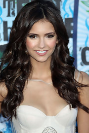 Nina Dobrev wore a shimmering warm pink lipstick at the 2010 Teen Choice Awards.