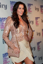 Megan Gale topped off her neutral ensemble with a quilted nude leather bag at the Vogue Fashion's Night Out after-party.
