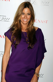 Kelly Bensimon styled her hair in soft long curls that were parted down the center.