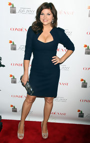 Tiffani Thiessen added shine to her ladylike shift with a multicolored snakeskin clutch.