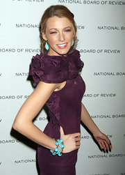 Blake put a punch in her ensemble with bright turquoise tear drop earrings and matching bangle bracelets.