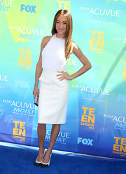 Maggie Q paired trendy black-and-white cap-toe pumps with an elegant all-white outfit when she attended the 2011 Teen Choice Awards.