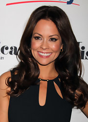Brooke Burke wore her ultra-glossy tresses in bouncy curls at the 2012 Miss America Pageant co-host press conference.