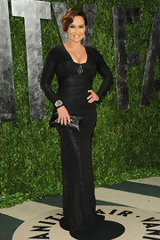 Tia Carrere opted for a simple black leather clutch when she attended the 2012 Vanity Fair Oscar party.