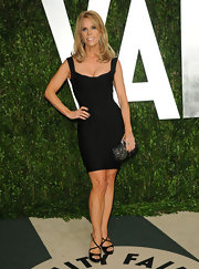 Cheryl Hines added height with strappy sandals.