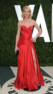 Kelly Lynch wore this ravishing red gown with a hip-high slit to the Vanity Fair Oscar party.