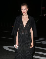 Karlie Kloss slung a black wool coat over her shoulders for some warmth to her lightweight dress as she headed to the 2016 Guggenheim International Gala.