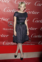 Carey Mulligan put her best foot forward in black patent platforms.