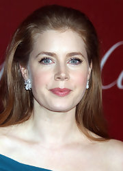 Amy Adams added some sparkle to her look with diamond flower earrings.