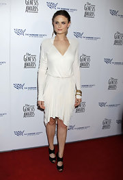 Emily Deschanel looked like a grecian goddess in her white draped dress. She added a nice contrasting color with her black chunky heels.