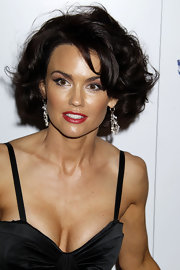 Kelly opted for a glamorous curled bob with red lipstick in glitzy earrings.