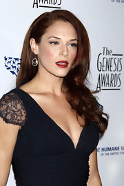 Amanda Righetti dazzled in her red side-swept locks. She pumped up the volume with a splash of red lipstick. Gorgeous!