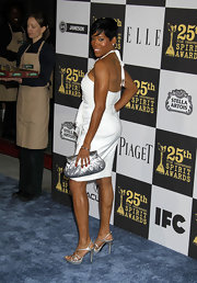 A curvy silhouette put a feminine spin on Regina King's metallic silver envelope clutch at the Film Independent Spirit Awards.